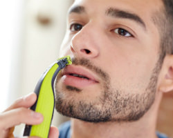 Philips Norelco OneBlade hybrid electric trimmer and shaver Edge it Up