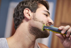Philips Norelco OneBlade hybrid electric trimmer and shaver Shave It Off